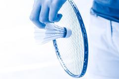 Closeup hand playing serve badminton. Stock Photos