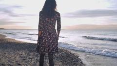 The Girl Walks on the Beach Stock Footage