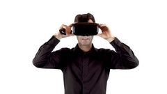 Man wearing virtual reality goggles and making his choice with beep box Stock Footage
