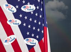 Many I Voted stickers on stars and stripes USA flag Stock Photos