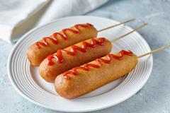 Corn dog traditional American corndog street junk food deep fried hotdog meat Stock Photos