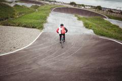 Cyclist riding BMX bike in skatepark Kuvituskuvat