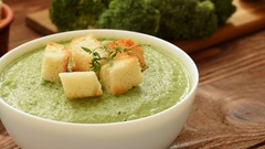 Cream - soup with broccoli in white bowl Stock Footage