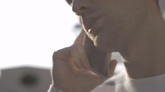 Profile view of handsome young man talking on the phone in town. Stock Footage