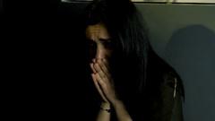 Man assaulting woman at night on street medium shot Arkistovideo