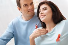 Cheerful pleasant couple taking part in the World AIDS Day Stock Photos