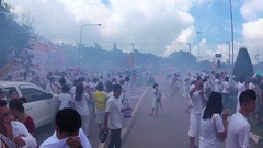 PHUKET, THAILAND October 7, 2016: Vegetarian festival. Firecrackers street war. Stock Footage