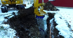 Digging hole in Limestone with a jackhammer during winter Stock Footage