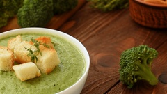 Ready cream - soup with broccoli in white bowl Stock Footage