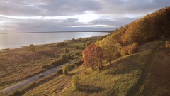 Aerial view autumn landscape, lake and forest with colorful trees Stock Footage