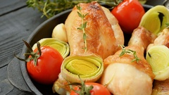 Chicken with leeks, cherry tomatoes, garlic and thyme Stock Footage