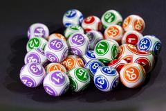 Colourful lottery balls in a sphere Stock Photos