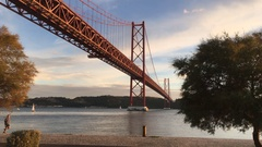 Lisbon Outdoor Activities, 25th de Abril Bridge Over Tagus River During Sunset Stock Footage