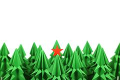 Origami christmas trees Stock Photos