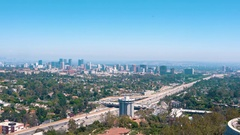 Traffic on 405 in freeway in LA with Century City in the background Stock Footage