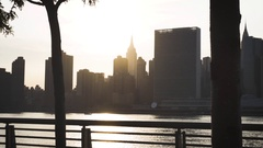 Establishing shot of New York City's Empire State Building at sunset Stock Footage