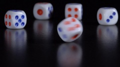 Dice throw on a black table Stock Footage