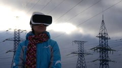 Young Woman With Virtual Reality Headset And High-Voltage Power Lines Stock Footage