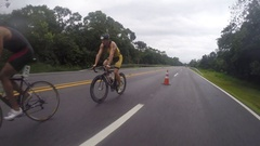 Cycling competition for triathlon on rainy day Stock Footage
