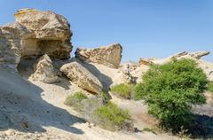 Natural rock formations and sparse vegetation at Lake Arco in Angola Stock Photos