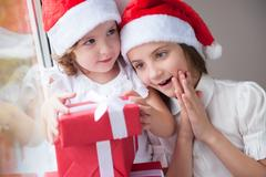 Two pretty little girls with Christmas gifts Stock Photos