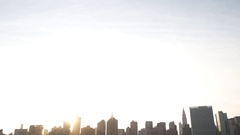 Establishing shot of New York City from the piers at sunset Stock Footage