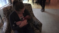 Holding New Baby Cousin on Thanksgiving Stock Footage