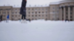 People are skating on the open skating ring on a cloudy day in winter in Stock Footage