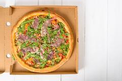 Italian Pizza With Green Fresh Rucola (Arugula), Prosciutto Ham And Parmigiano Stock Photos