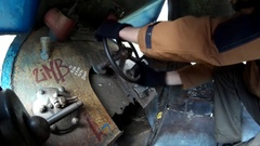Mans hands turninng wheels and tumbler switches in metalic cockpit Stock Footage