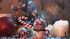 New year still life with Christmas motifs: candles, Santa, toys Stock Footage