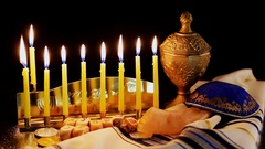 Jewish holiday Hanukkah with menorah over wooden table Stock Footage