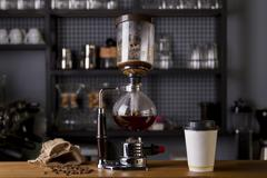 Japanese Siphon Coffee Maker with Halogen Beam Heater Stock Photos