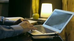Man in shirt works at the computer at home Stock Footage