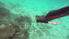 Woman snorkeling near the shore of Santiago island Stock Footage