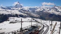 Gornergrat Train Leaving Station With Matterhorn In Background Stock Footage
