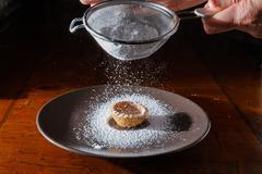 Sprinkle with powdered sugar Stock Photos