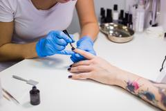 Manicurist master makes manicure Stock Photos