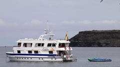 White yacht anchored in a bay near North Seymour island, Galapagos, Ecuador Stock Footage