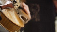 Close-up of musician playing at violin Stock Footage
