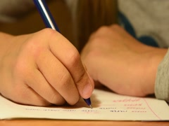 Schoolboy slow first-grader wrote the word in the notebook, close-up Stock Footage