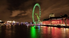Time-lapse of London Eye at night from Westminster Bridge Stock Footage