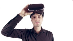 Man wearing virtual reality goggles. Studio video, white background Stock Footage