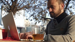 Writer typing outside on a mobile computer Stock Footage