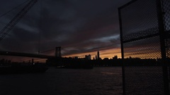 A silhouette of NYC's Williamsburg Bridge at susnset Stock Footage