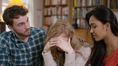 4K Students living in shared accommodation, girl upset is comforted by friends Stock Footage