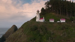 Flying backwards viewing Heceta Head Lighthouse Stock Footage