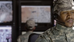 Military drone operator reading his computer screen Stock Footage