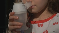 Little girl making inhalation. procedure inhalation of child Stock Footage