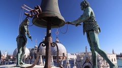 Half naked bell ringer Moors statue, Venice clock tower roof Stock Footage
